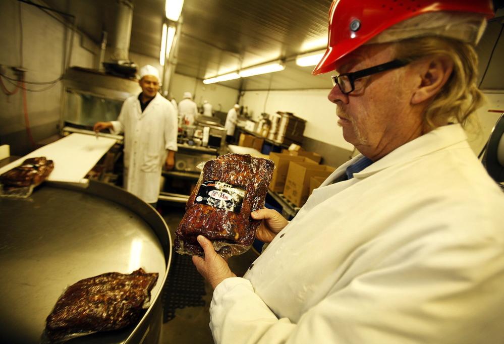 Jerry Haines, right, general manager at R.C. Provisions in Burbank, Calif., holds packaged pastrami ready for shipping. Beef prices are at record highs because of thinning cattle herds decimated by drought. The nearly 50-year-old company's soaring cost of raw materials has driven their profit margins to near zero.