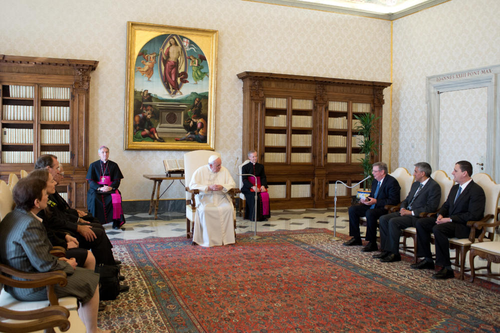 Pope Francis meets members of the International Catholic Child Bureau at the Vatican on Friday.