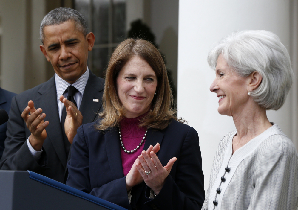 President Obama, and his nominee for Health and Human Services secretary, current Budget Director Sylvia Mathews Burwell, center, applaud outgoing Health and Human Services Secretary Kathleen Sebelius on Friday in the Rose Garden at the White House in Washington.