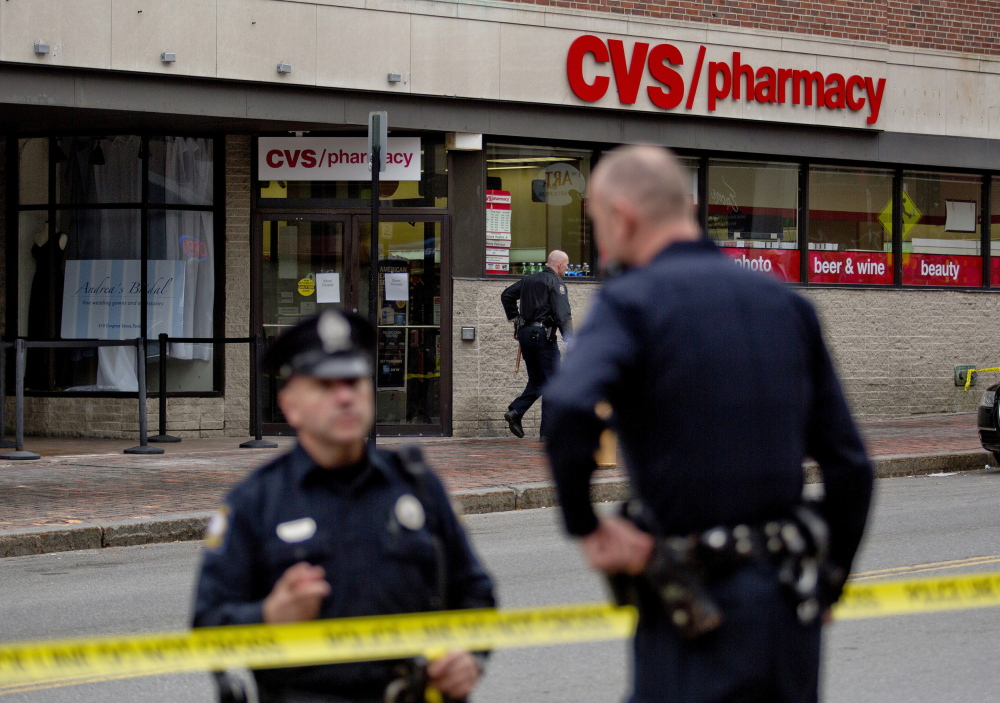 Portland police investigate the robbery of the CVS store at 510 Congress St. Friday.