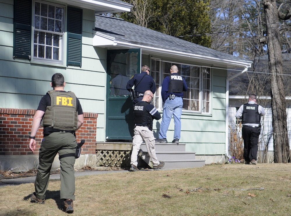 Police search the Augusta residence on Thursday where Gretchen Patrick, 51, was summoned on a charge of sex trafficking. Police allege that Patrick operated Sarah's Place from a mobile home on Route 126 in Litchfield.