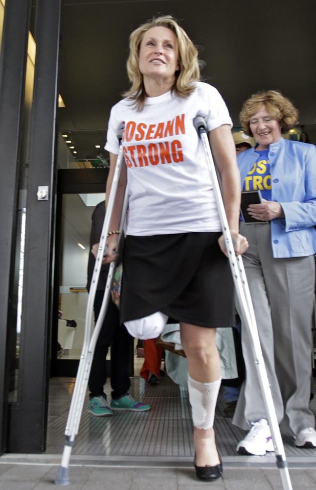 Boston Marathon bombing survivor Roseann Sdoia leaves Spaulding Rehabilitation Hospital in Boston a month after being injured at the finish line on April 15, 2013. She continues to live and work in Boston.