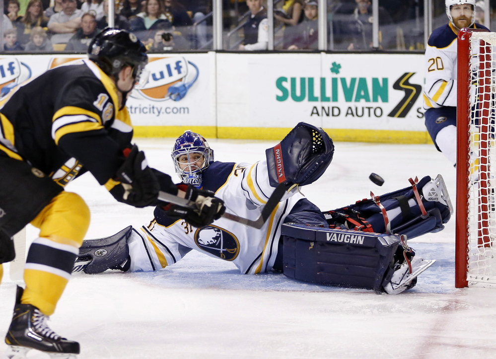 Reilly Smith of the Bruins shoots wide of Sabres' goalie Matt Hackett in the second period Saturday at TD Garden in Boston.