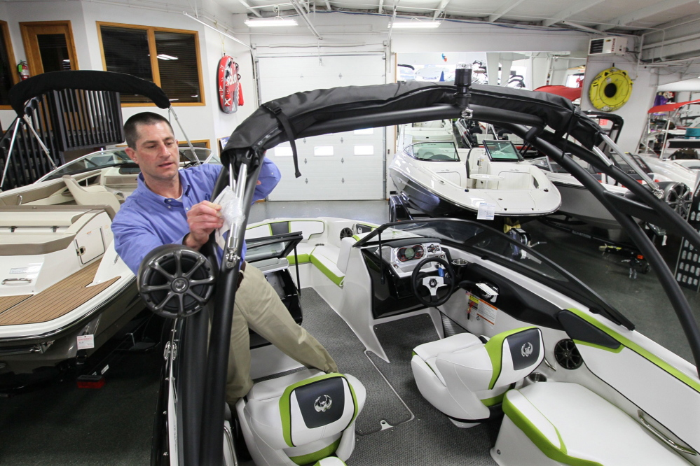 Todd Riepe gets a Scarab jet boat ready for sale at SkipperBud's boat dealership in Pewaukee, Wis. Boat builders are trying to give consumers the content they want without having hundreds of options, which add to a company's costs.