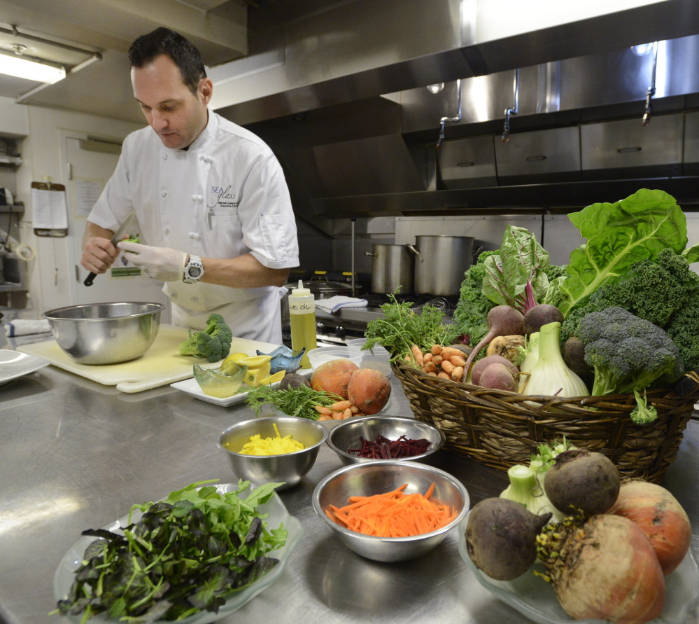 Kaldrovich trims broccoli for the salad, which also includes beet and carrot tops and fennel fronds.