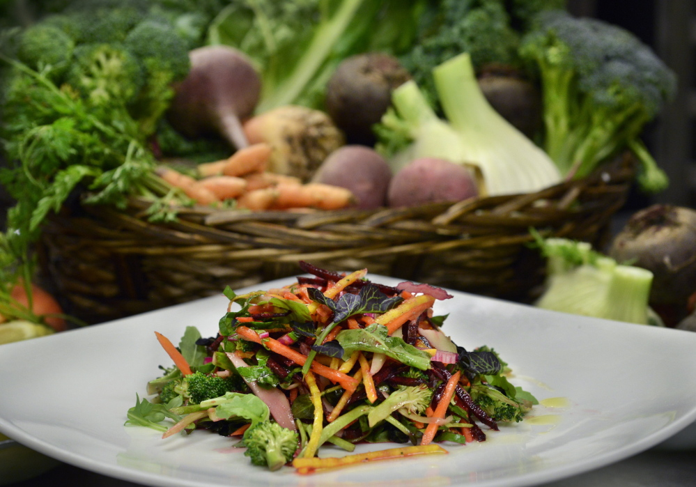 Chef Mitchell Kaldrovich makes a salad of beets, broccoli stems and leaves at his Sea Glass Restaurant at Inn by the Sea in Cape Elizabeth. Kaldrovich sources local products and strives to use them as entirely as possible.