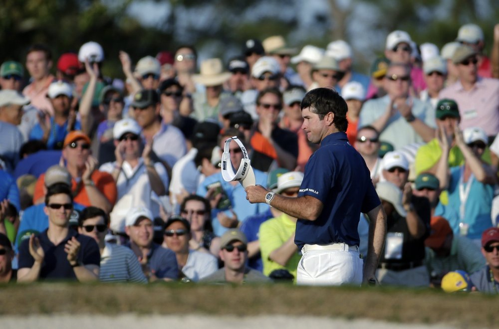 The Associated Press Spectators cheer as Bubba Watson walks up the 18th fairway during the third round of the Masters golf tournament Saturday in Augusta, Ga.