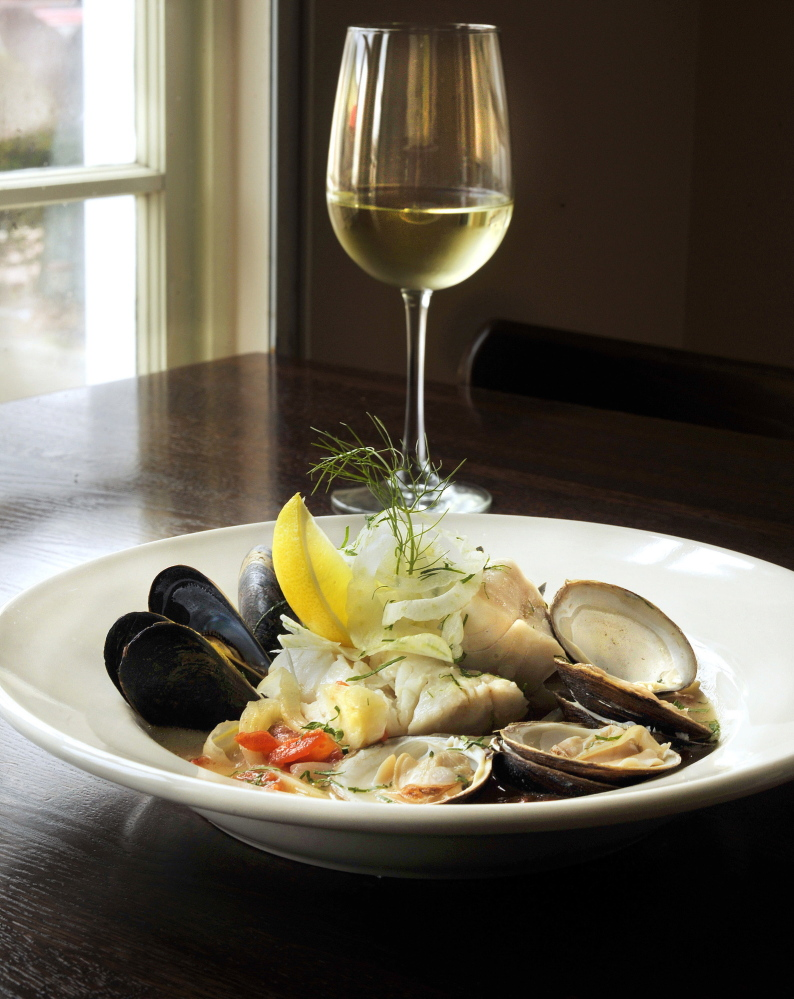 Azure Cafe's Zuppa de Pesce features Maine mahogany clams, mussels and Maine white fish in a saffron broth with fresh fennel slaw.