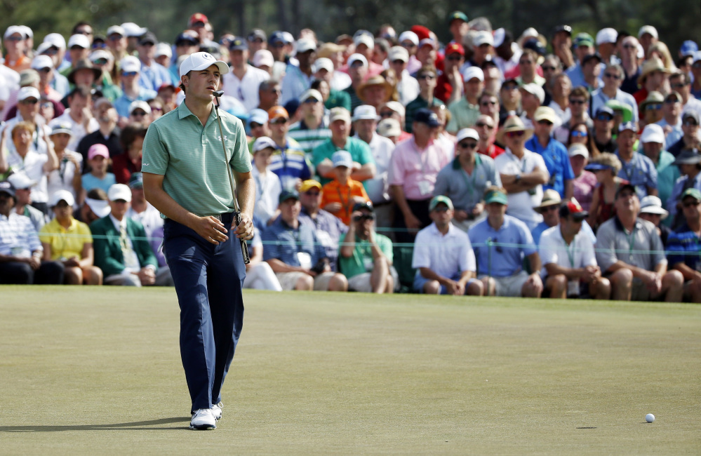Jordan Spieth reacts as his ball misses the cup on the ninth hole for a birdie during the fourth round of the Masters.