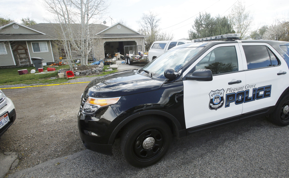 Pleasant Grove Police investigate the scene where seven infants' bodies were discovered Sunday.