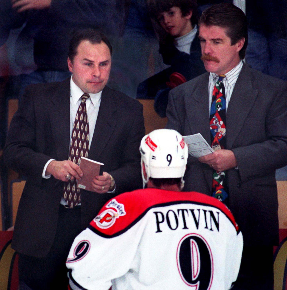 STAFF PHOTO BY GORDON CHIBROSKI -- Thursday, October 24, 1996 -- Barry Trotz, Portland Pirates' coach, and assistant coach Paul Gardner, listen to Marc Potvin's concerns during a game at the CCCC.