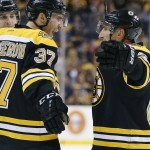 Boston faces Detroit on Friday, but Patrice Bergeron, left, and Brad Marchand are part of a Bruins team loaded with postseason experience.