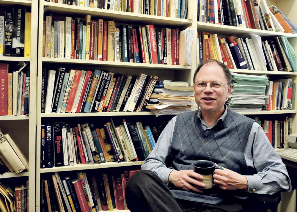 Robert Weisbrot, Colby College history professor, in his office in Waterville on Monday says the loss of hard copies of books arranged in library stacks hurts teaching and research.