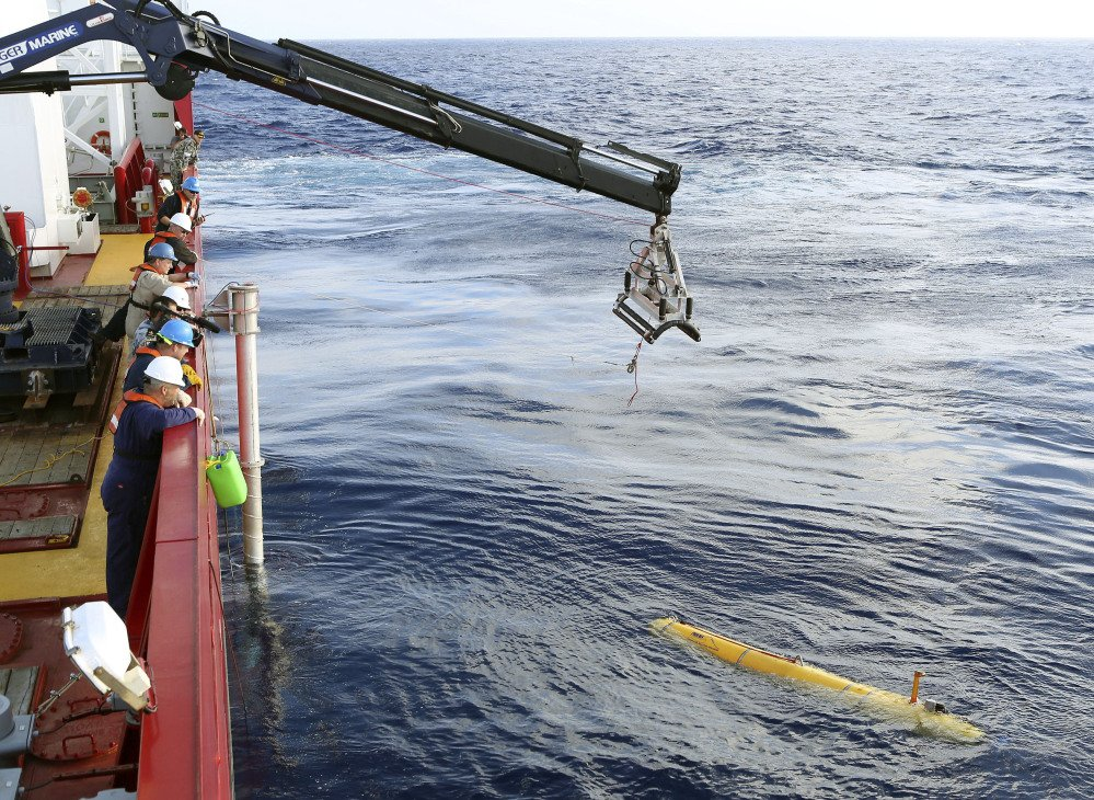In this Monday, April 14, 2014, photo provided by the Australian Defense Force an autonomous underwater vehicle is deployed from ADV Ocean Shield in the search of the missing Malaysia Airlines Flight 370 in the southern Indian Ocean. The search area for the missing Malaysian jet has proved too deep for the robotic submarine.