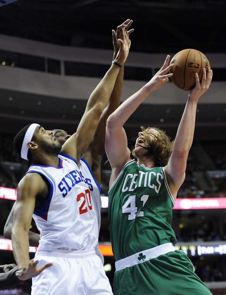 Boston's Kelly Olynyk goes up for a shot against Brandon Davies of the 76ers during the Celtics' 113-108 loss at Philadelphia on Monday. Olynyk led Boston with 28 points.