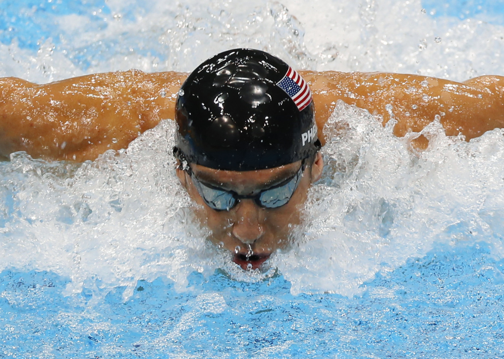 Michael Phelps swims in the men's 4 X 100-meter medley relay at 2012 Summer Olympics in London, in this Aug. 4, 2012, photo.
