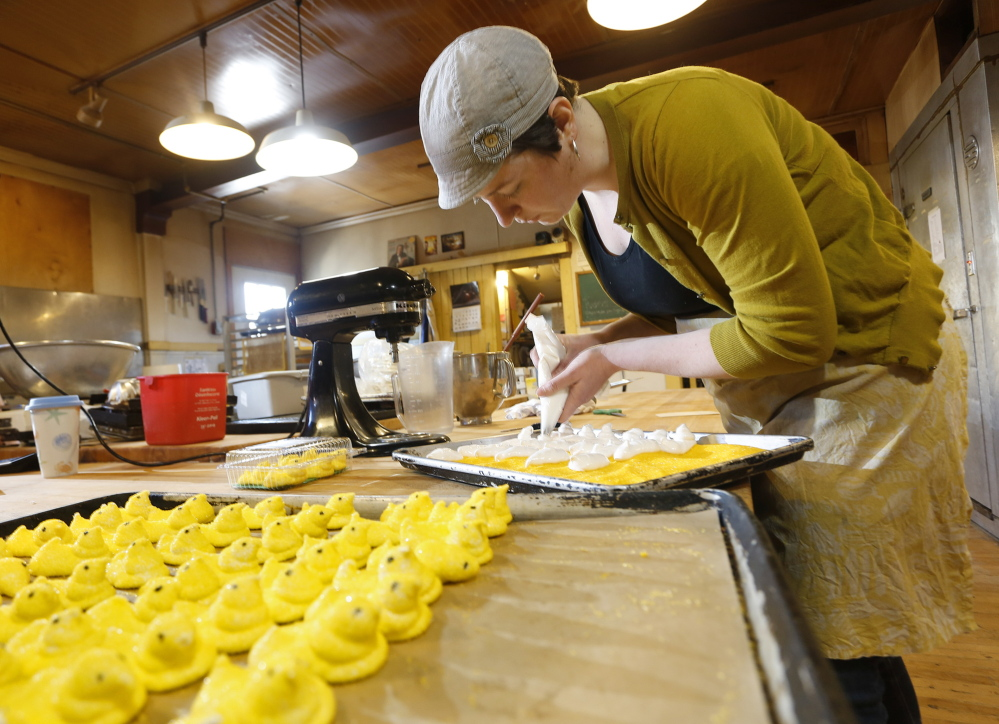 Kelly Donohoe works on a batch of Rosemont Markets' take on Peeps, the iconic Easter candy that (sadly, some say) aren't just for Easter anymore. The version that Rosemont is producing for this Easter season contains just three main ingredients: sugar, gelatin and vanilla.
