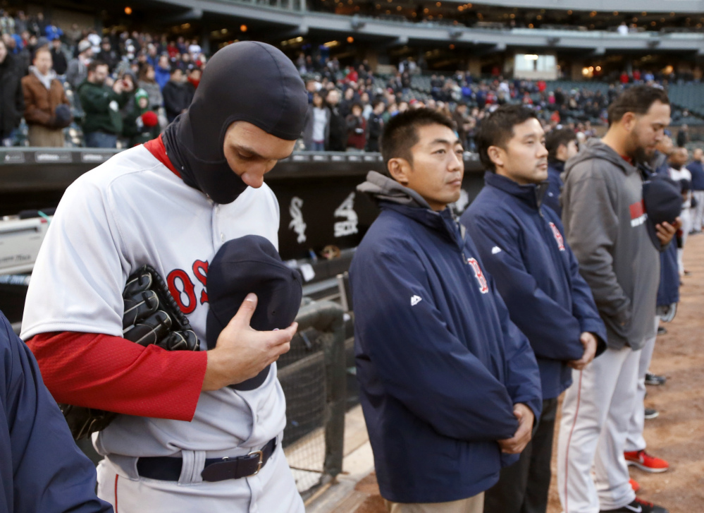 Red Sox center fielder Grady Sizemore, left, stands with his teammates during a moment of silence for the victims of the Boston Marathon bombings, before the game against the Chicago White Sox on Tuesday in Chicago.
