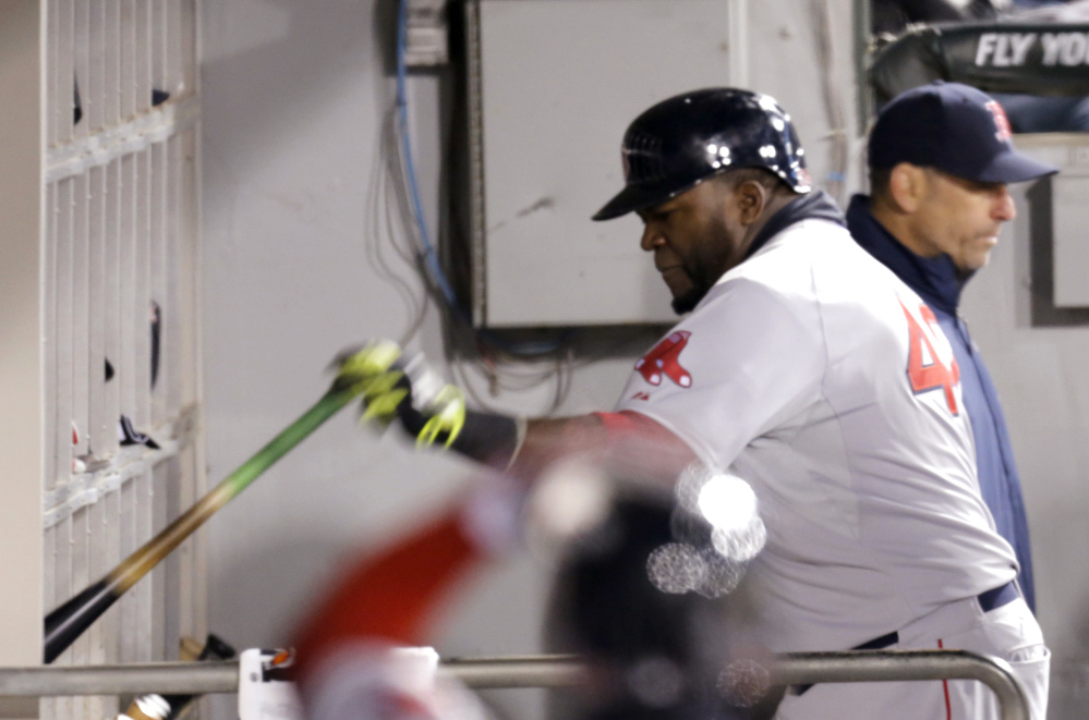 David Ortiz slams his bat into the rack after striking out in the fourth inning.