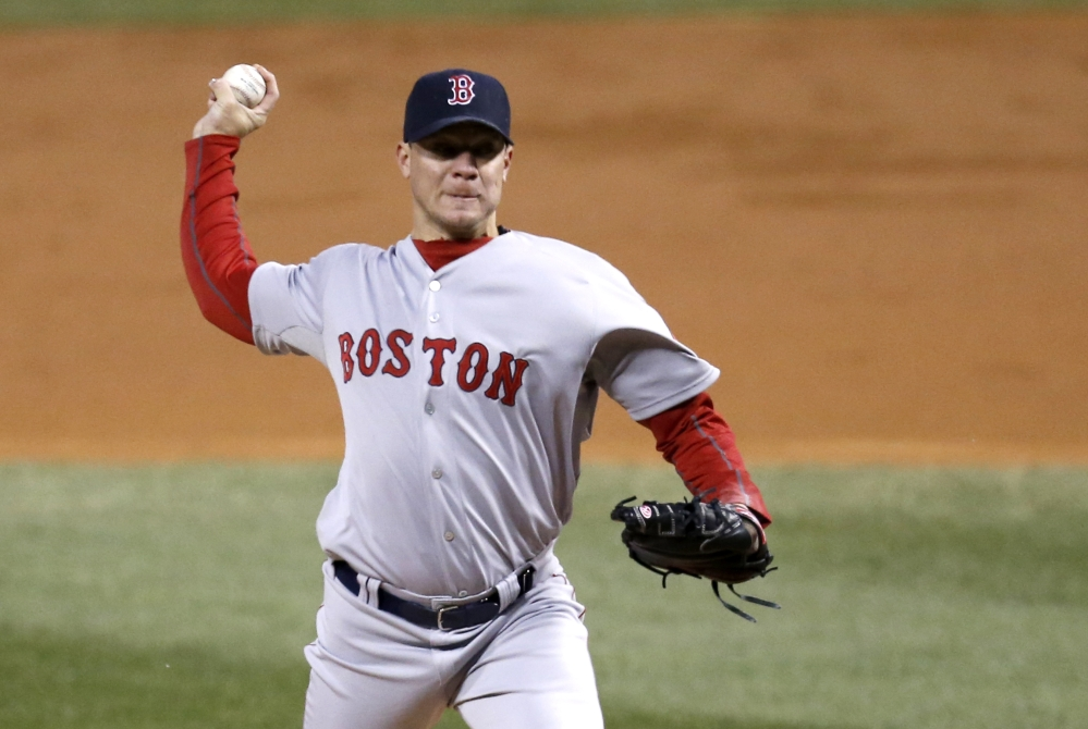 Boston Red Sox starting pitcher Jake Peavy delivers during the second inning of a baseball game against the Chicago White Sox on Tuesday, April 15, 2014, in Chicago. (AP Photo/Charles Rex Arbogast)