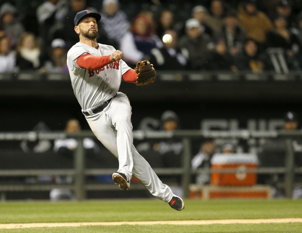 Boston Red Sox third baseman Ryan Roberts is unable to throw out Chicago White Sox's Alejandro De Aza after fielding De Aza's bunt during the fourth inning Wednesday in Chicago.