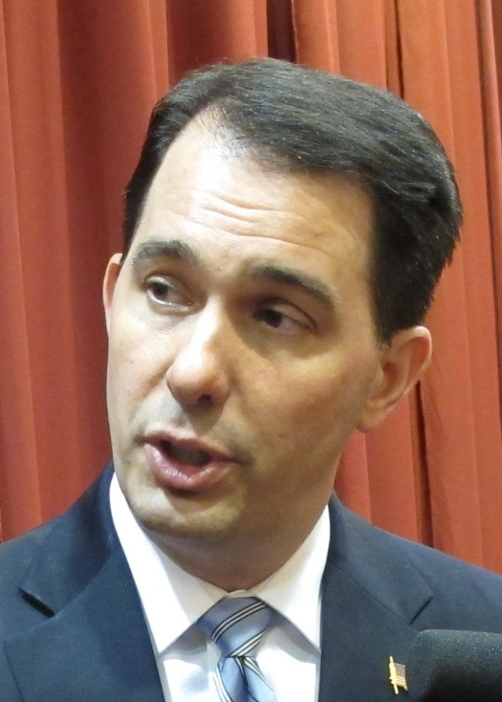 Wisconsin Gov. Scott Walker answers questions from reporters on Wednesday in Madison, Wis. Liberal rocker John Mellencamp wants conservative Republican Gov. Walker to know he supports union rights and says Walker should think about that before using his songs on the campaign trail.