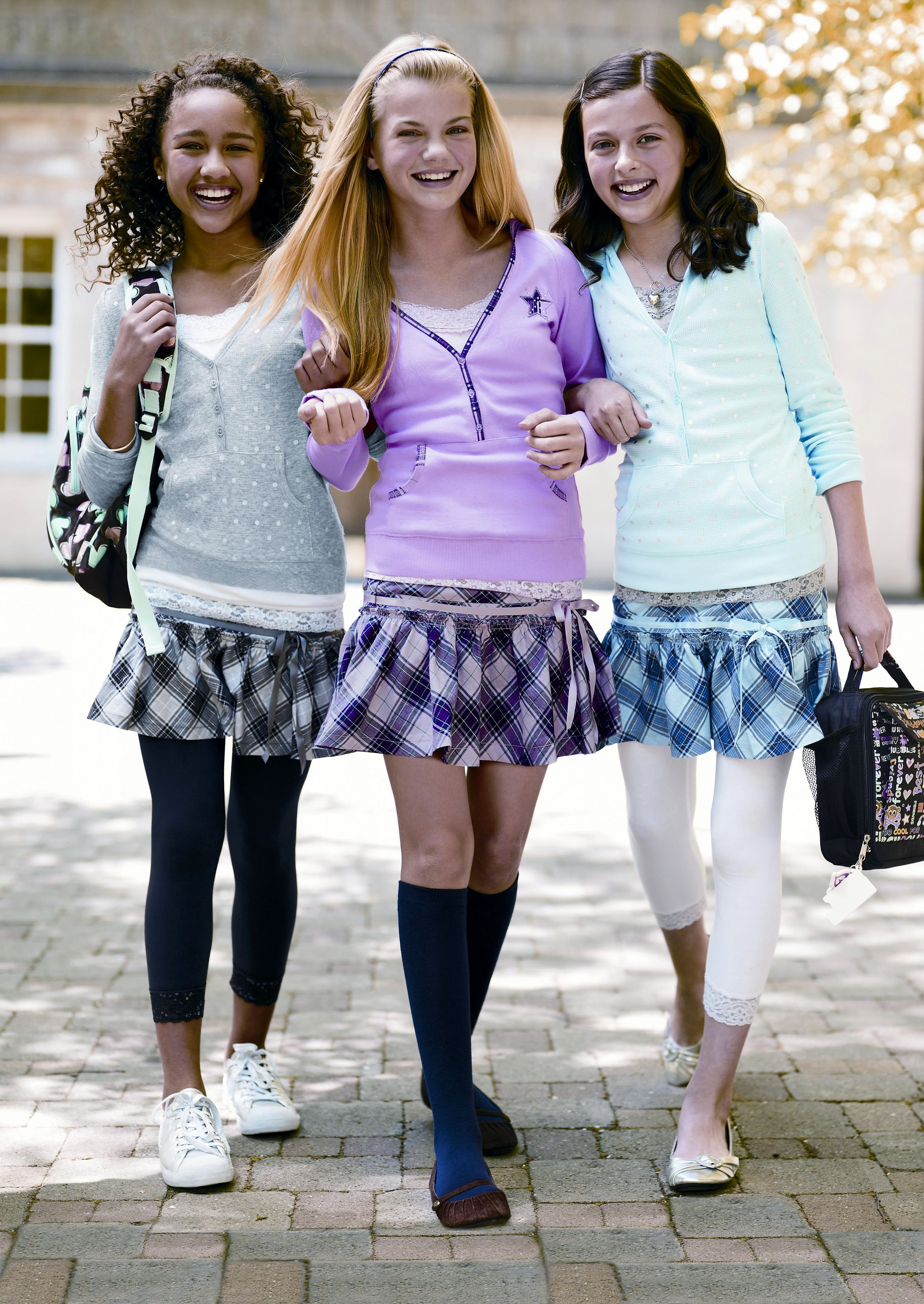 Models wear tights and leggings, which are among the articles of clothing that have been targeted by some school districts.