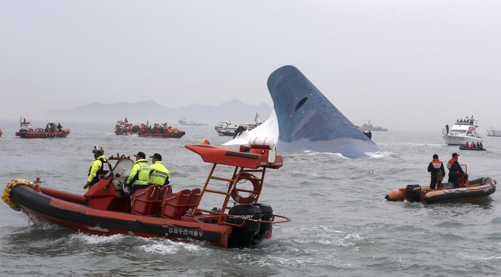 South Korean coast guard officers and rescue team members try to rescue passengers from the ferry Sewol in the water off the southern coast near Jindo, south of Seoul, on Wednesday.