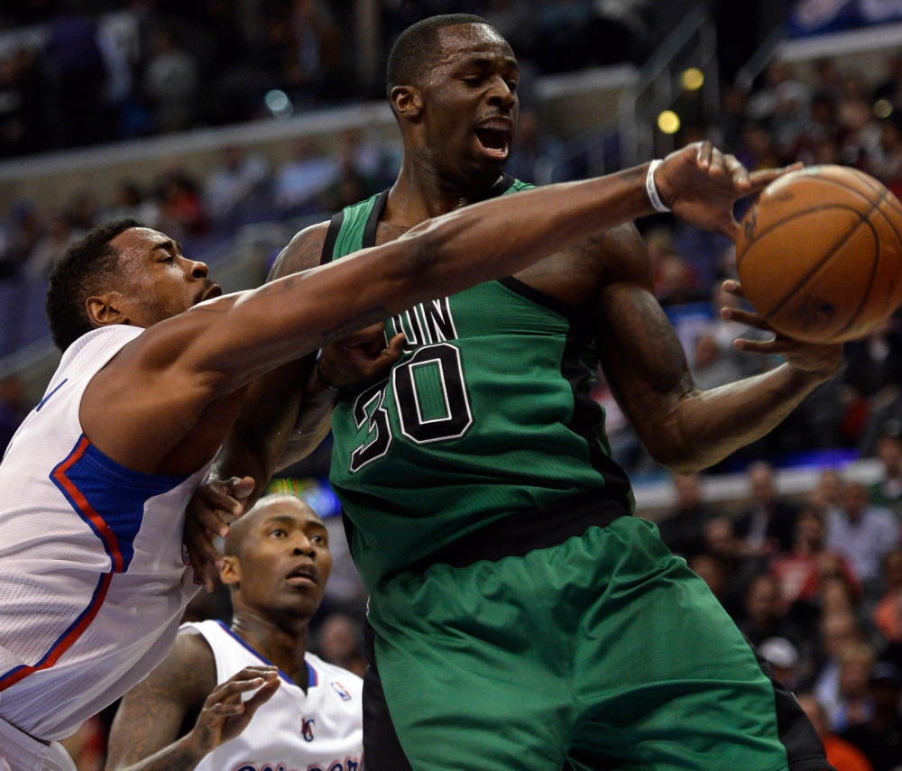 Brandon Bass, right, had a productive season with the Boston Celtics and may remain a piece of the puzzle – along with Jeff Green, Kelly Olynyk, Jared Sullinger and Avery Bradley. The road back to contending also figures to include high draft picks who are on the way.