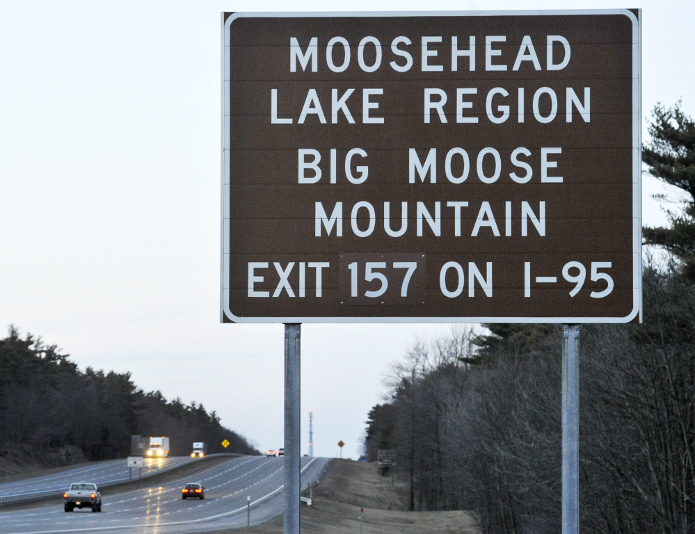 A bill that Gov. Paul LePage signed into law targets brown and white highway signs that direct visitors to attractions.