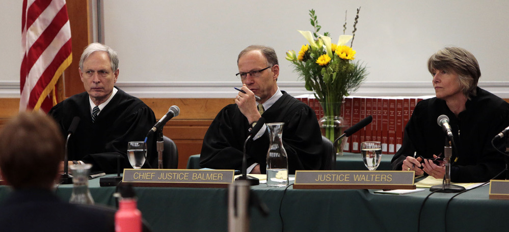 Oregon Supreme Court Chief Justice Thomas A. Balmer, center, flanked by Justices Rives Kistler and Martha Walters, hears arguments that could reverse a murder conviction that was based on eyewitness identifications.