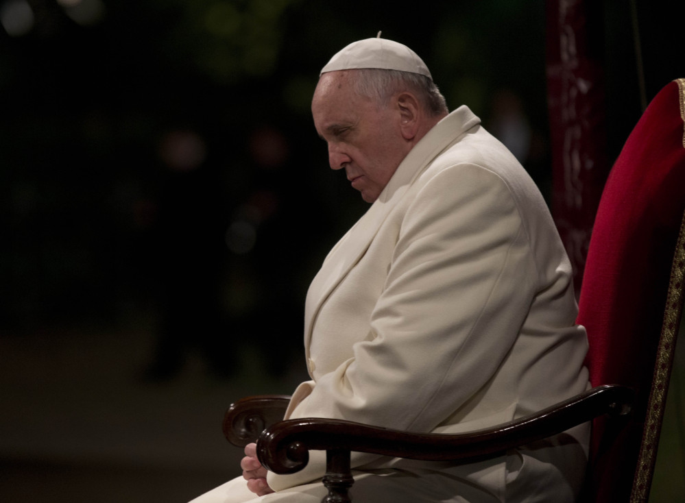 Pope Francis attends the Way of the Cross torchlight ceremony marking Good Friday in Rome.