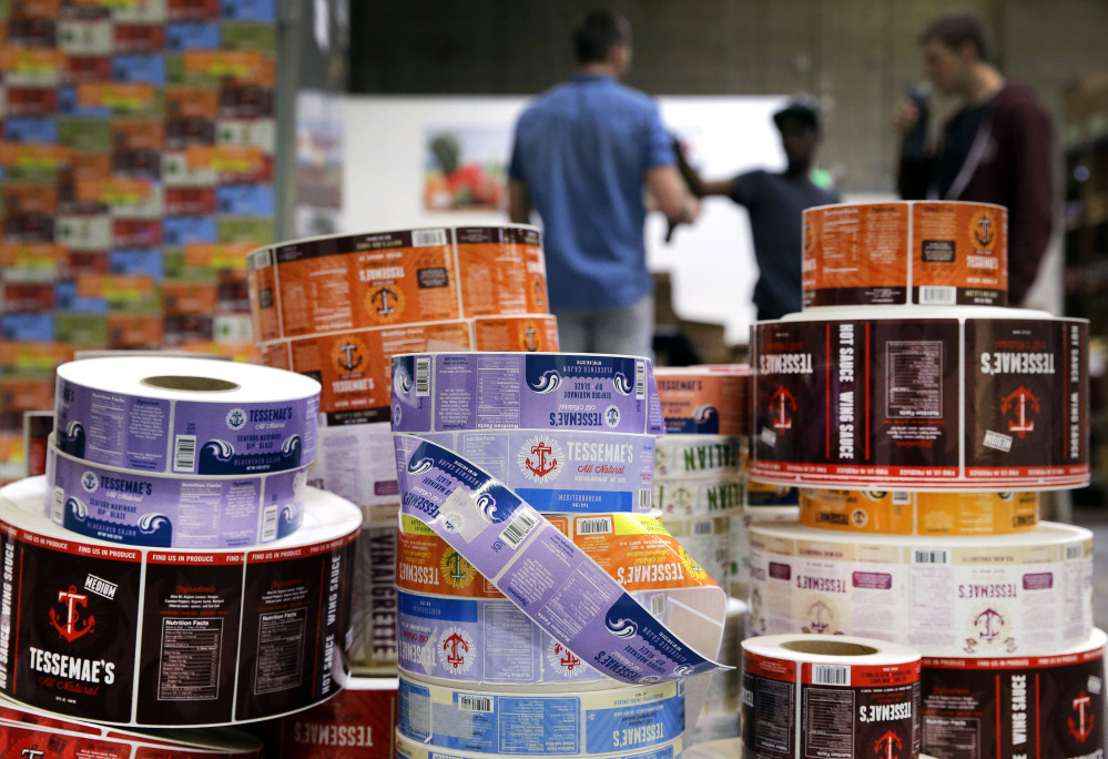 Product labels sit on a pallet at Tessemae's offices in Essex, Md., on Thursday. The owners of the small company were thrilled with the sudden massive demand for its salad dressing – but they were not prepared for the costs and complexities of satisfying that demand.