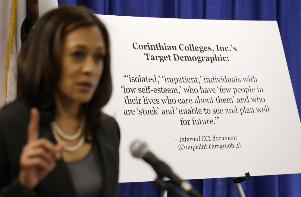 California Attorney General Kamala Harris stands next to a statement of the target demographic of the for-profit Corinthian Colleges Inc., which is facing a lawsuit.
