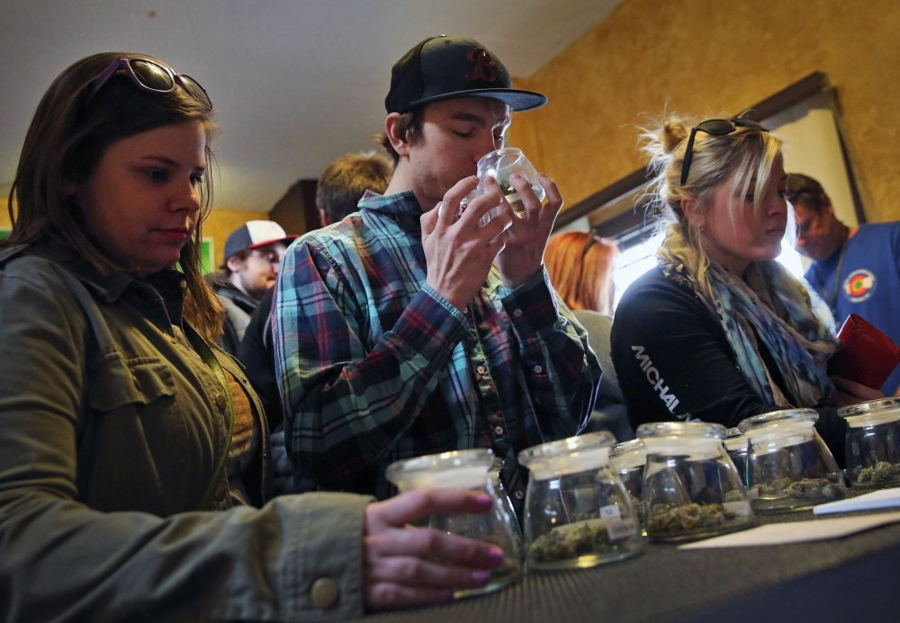 Customers shop for marijuana Friday in Denver. Two recent deaths have raised concerns about Colorado's recreational marijuana industry and the effects of the drug, since cookies, candy and other edibles can be exponentially more potent than a joint.