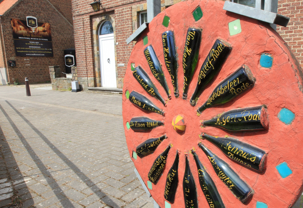"""Artwork outside one of the last authentic lambic breweries, """"Oud Beersel"""" in Beersel, Belgium, displays bottles from rivals who no longer produce geuze, a native variety. Thousands of Belgian pubs have closed in the past 20 years, but a brewers federation is trying to reinvigorate the country's thirst."""