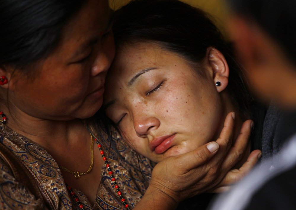 A daughter of a Nepalese mountaineer who was killed in Friday's avalanche on Mount Everest cries as her father's body arrives at a Katmandu monastery.