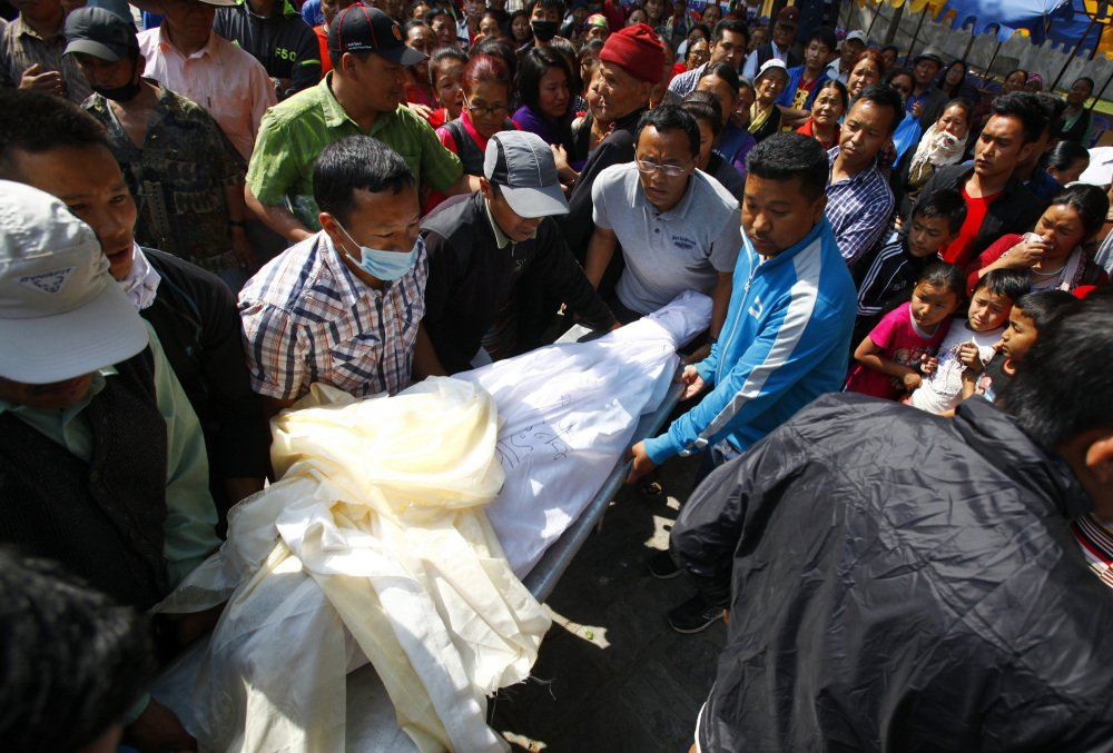 The body of Nepalese mountaineer Ang Kaji Sherpa, killed in an avalanche on Mount Everest, is carried to the Sherpa Monastery in Katmandu, Nepal, Saturday.
