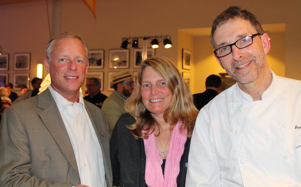 Dan Gibbons of Portland, left, with Cyndi Smith of Maine Magazine and David Turin, chef and owner of David's Monument Square and Opus 10 in Portland and David's 388 in South Portland, at the April 3 benefit for Easter Seals Maine at the Ocean Gateway in Portland