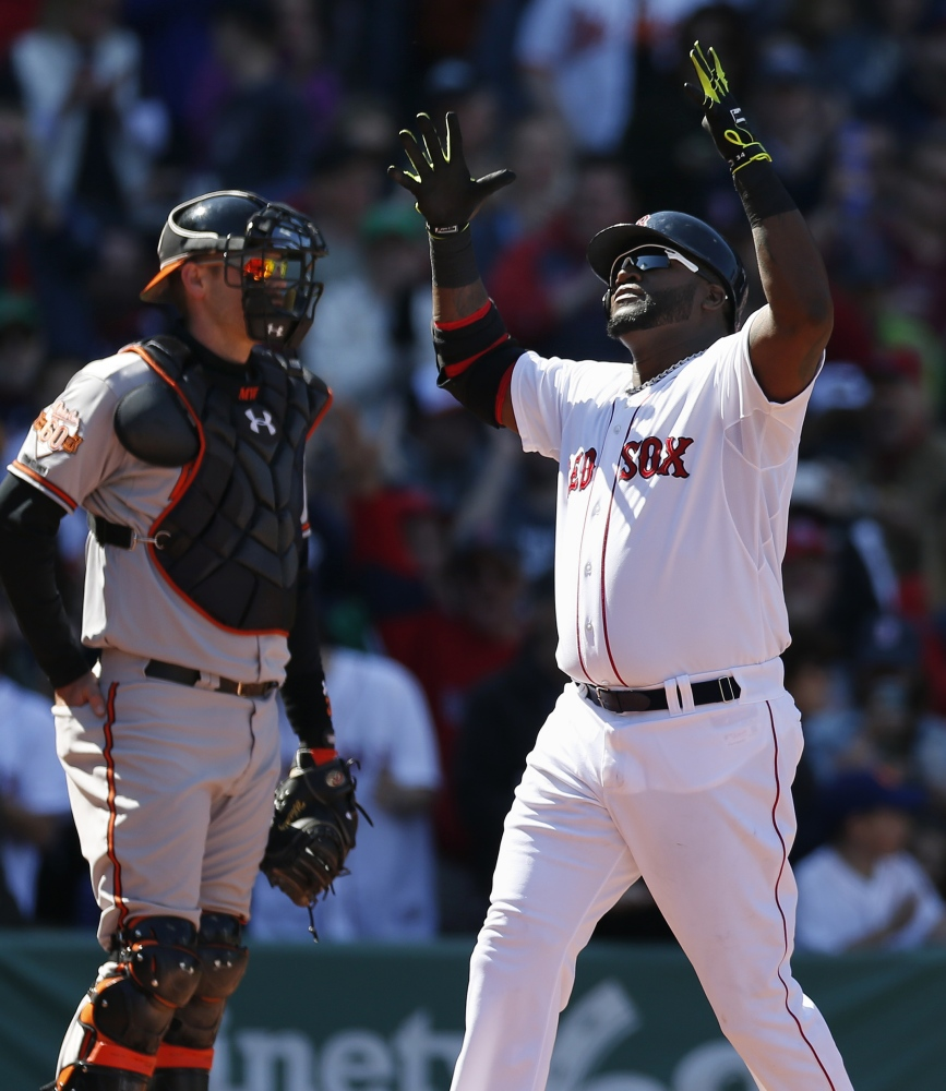 Boston Red Sox's David Ortiz celebrates his home run in front of Baltimore Orioles' Matt Wieters in the fourth inning of Saturday's game.