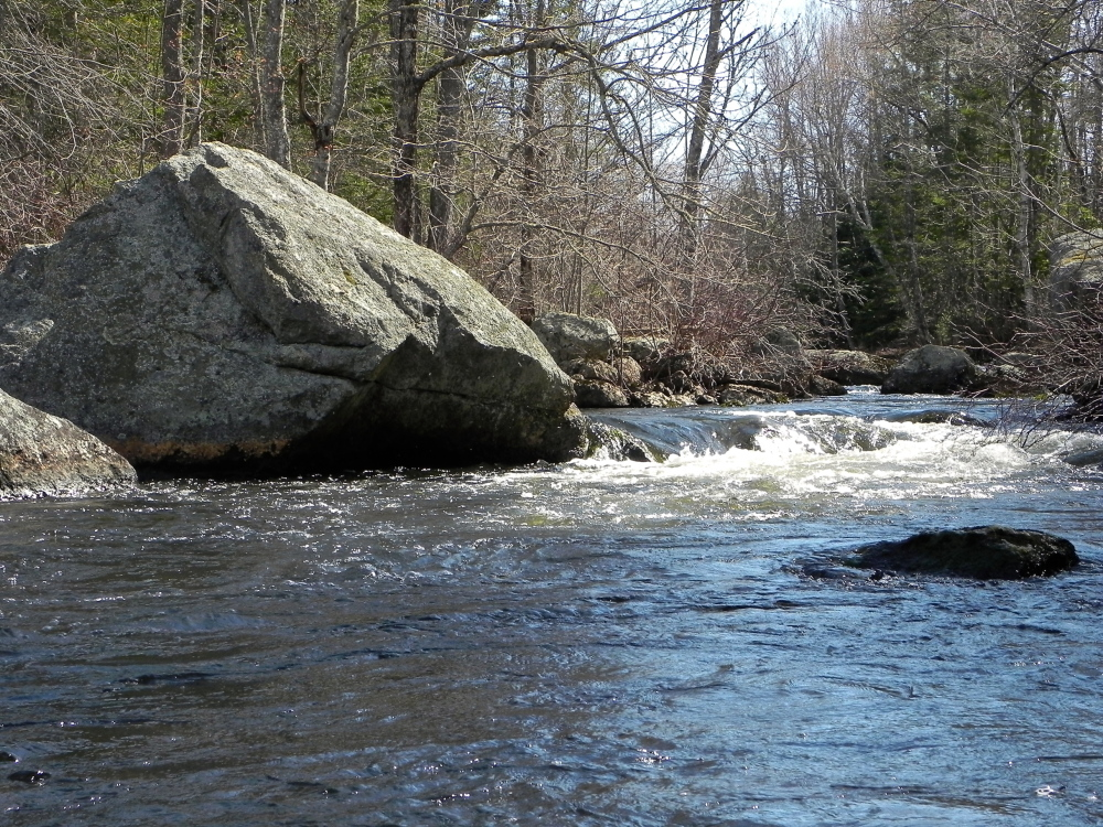 The cascading waters where Hellhole Stream drops into the Dead River can provide a taste of whitewater to your otherwise serene trip to Alamoosook Lake.