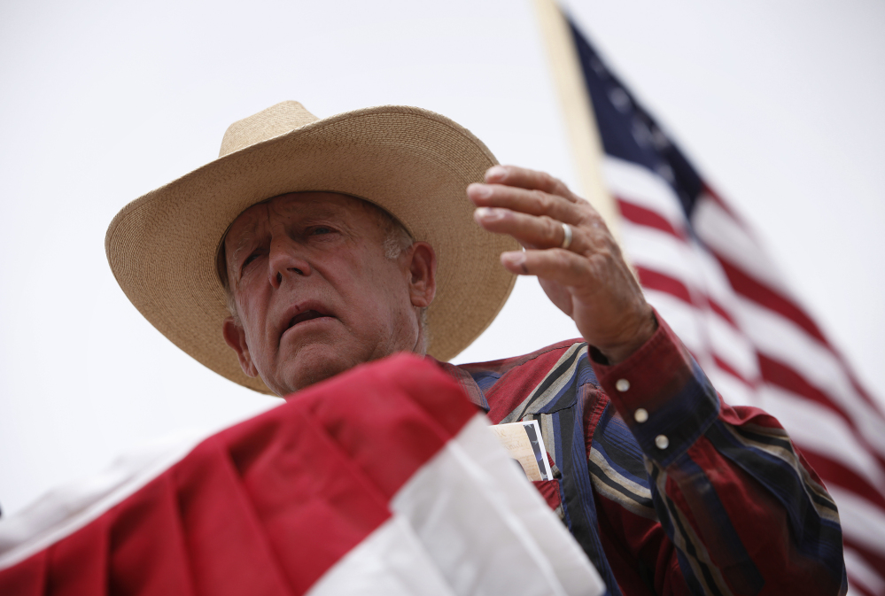 Rancher Cliven Bundy speaks at a protest camp near Bunkerville, Nev., on Friday.