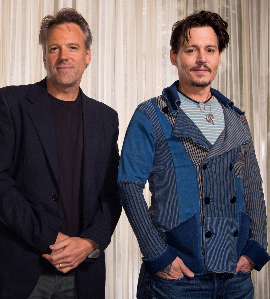"""""""Transcendence"""" director Wally Pfister, left, with his star, Johnny Depp"""