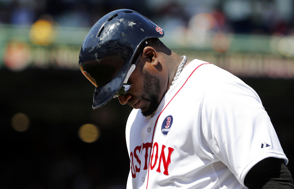 Red Sox designated hitter David Ortiz heads back to the dugout after lining out to end the fifth inning against the Orioles at Fenway Park on Monday.