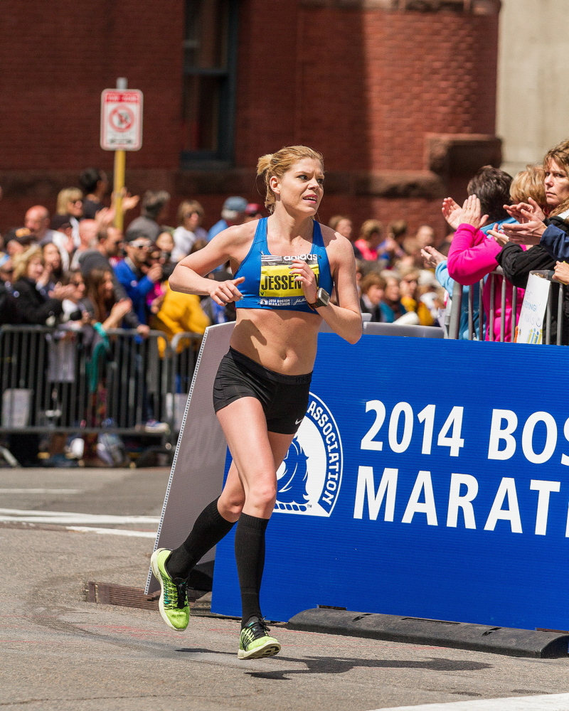 "Erica Jesseman of Scarborough, the top Maine female runner, heads onto Boylston Street, a quarter-mile from the finish, after earlier thinking, ""I can't do this. I'm not strong enough."""