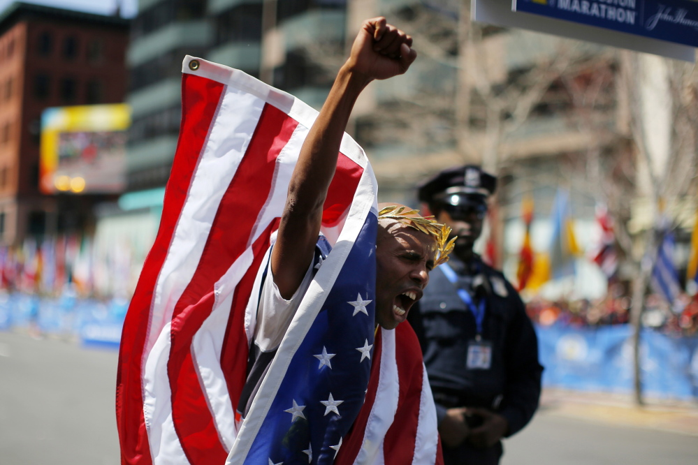 Meb Keflezighi wins the men's division of the 118th running of the Boston Marathon in Boston on Monday.
