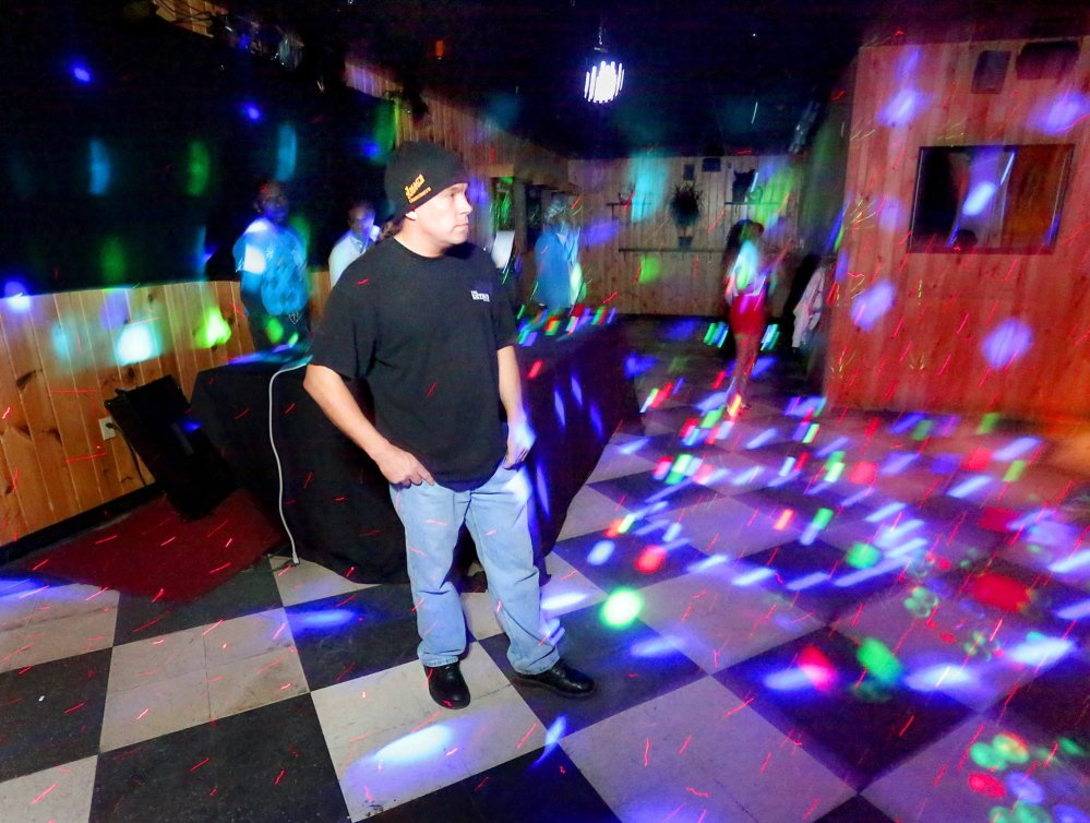 Allen Moore, owner of Skybox Bar & Grill in Westbrook, stands on the dance floor before a show April 18.