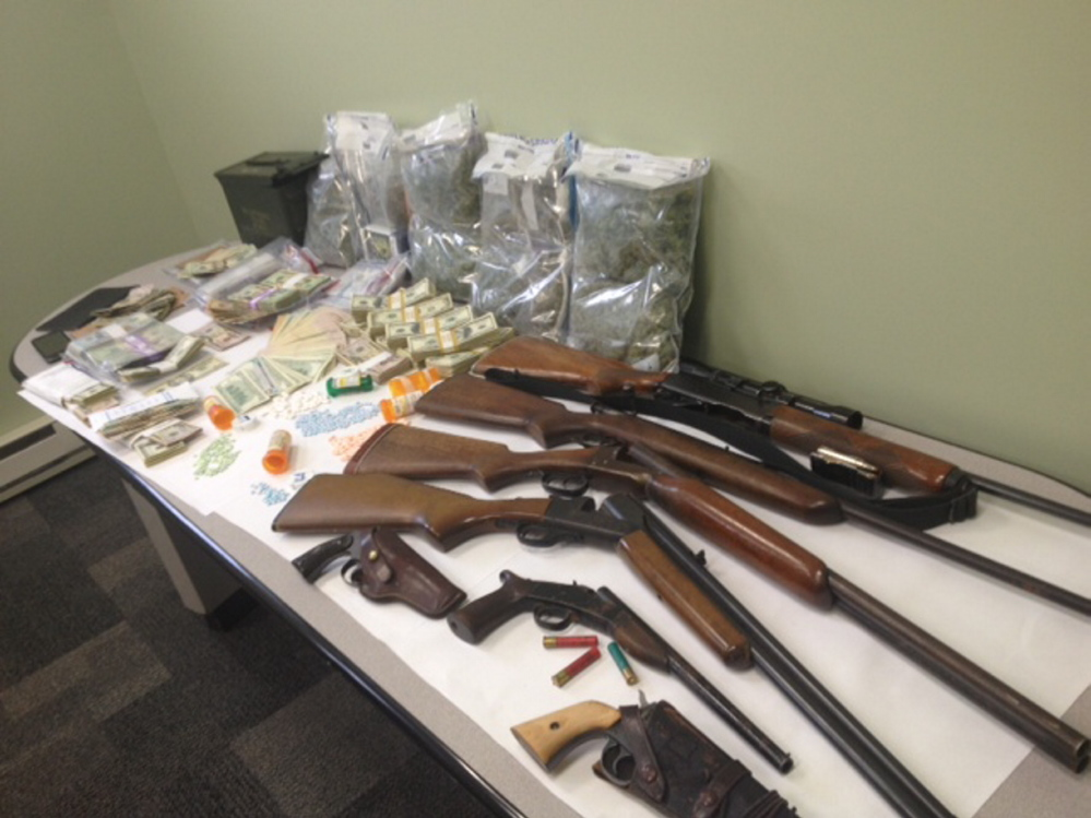 Seized in an Avon drug bust were 442 pills, seven firearms and more than $144,000 in cash.