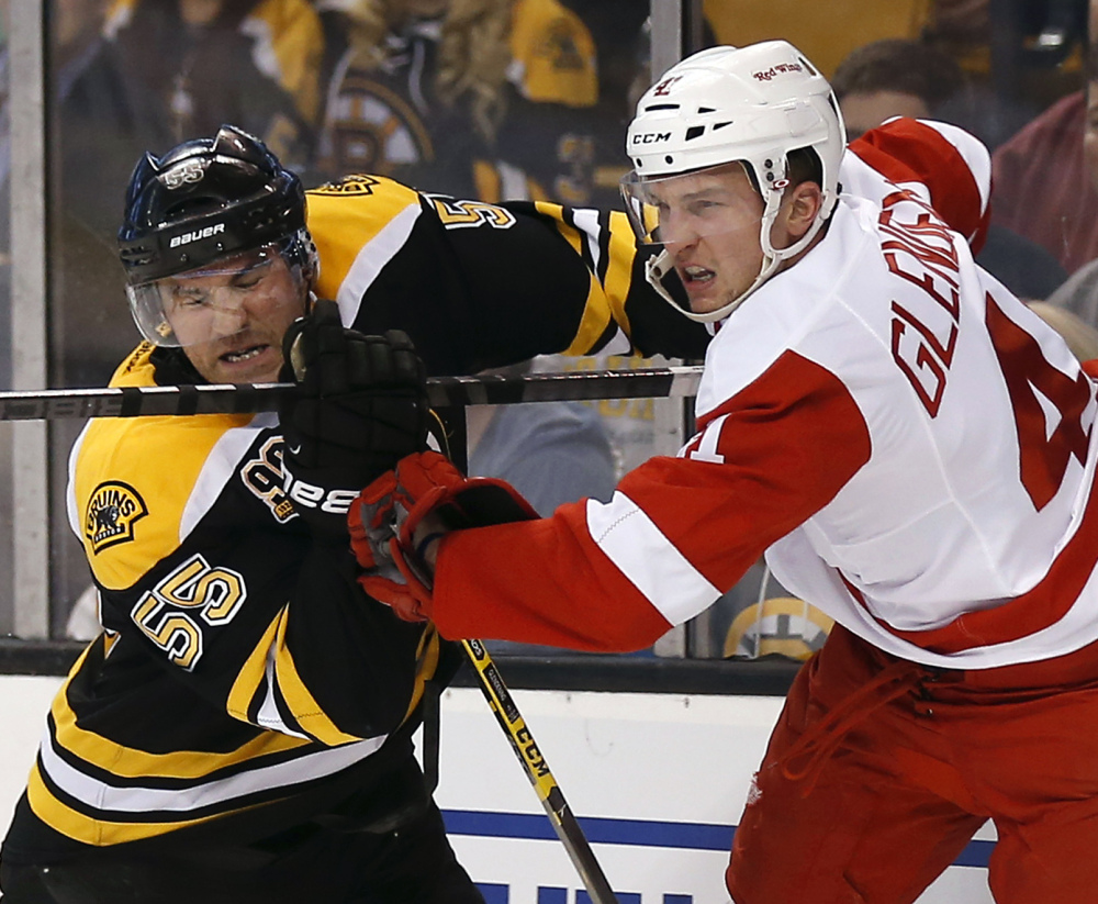 Johnny Boychuk, left, and the Boston defense has been able to shut down Luke Glendening and the high-scoring Red Wings through three games.