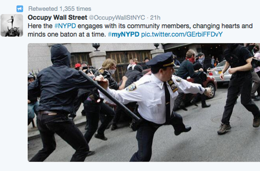 This image was posted in response to a Twitter request by the NYPD to offer up feel-good photos of people posing with police officers.